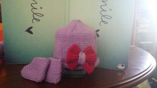 Matching baby booties and beanie with bow :)