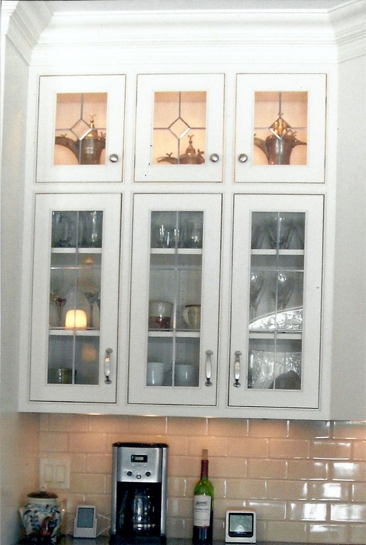 The 25 best glass cabinet doors ideas on pinterest glass white kitchen cabinets with glass inserts eventelaan Image collections