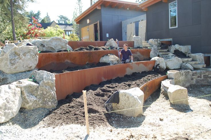 Patio Retaining Wall Construction Details : Incorporate boulders and metal retaining wall into garden