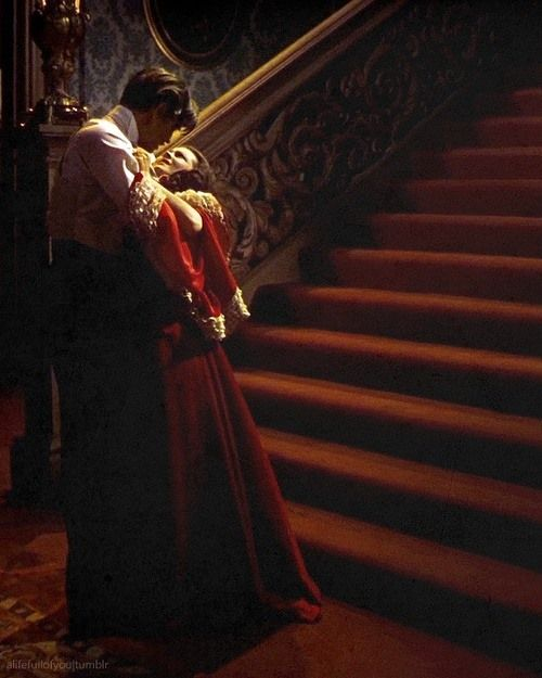 """A very drunk Rhett Butler tells Scarlett, """"this is one night you're not turning me out!"""" Clark Gable did not carry Scarlett up the stairs. He had a bad back and had to use a double for the take."""