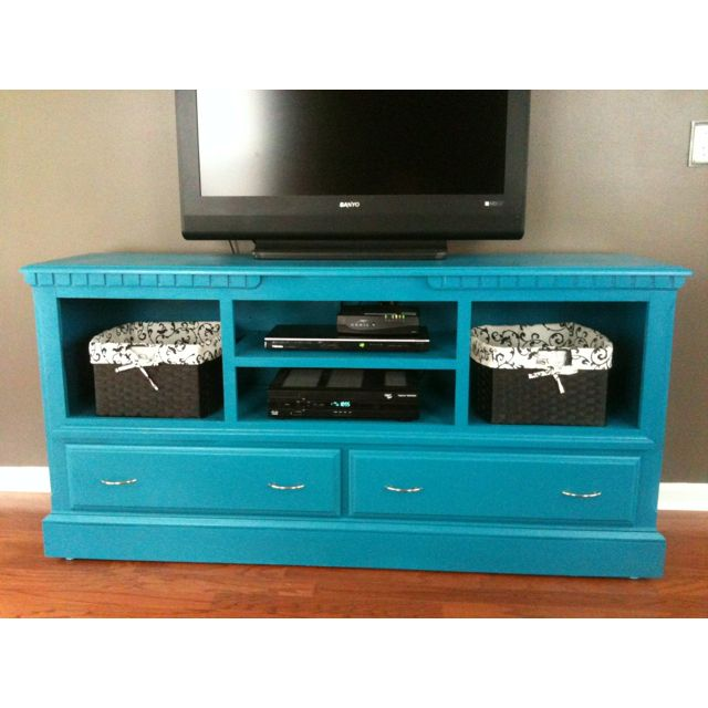 I like the use of the open space with baskets.    Refurbished dresser into an entertainment center