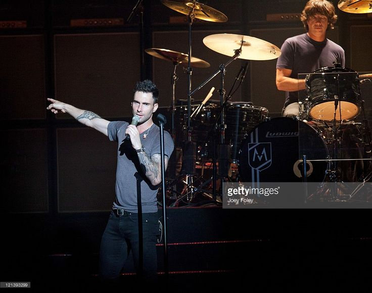 Lead Vocalist, Adam Levine and Drummer, Matt Flynn of Maroon 5 perform onstage at Conceso Fieldhouse on August 18, 2011 in Indianapolis, Indiana.