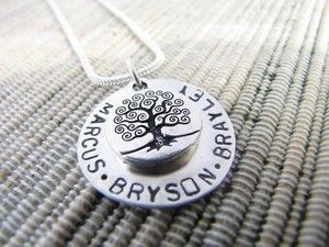 I have this.  The company is called Love Stamped.  I bought a groupon and got it with an extra disc for all the kids names.  I added birth stones as well.  I adore it!