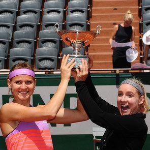 Women's doubles final.No.7 seeds Lucie Safarova and Bethanie Mattek-Sands hoist their trophy after their three-set win (3-6, 6-4, 6-2). Sunday 07 June 2015. © FFT
