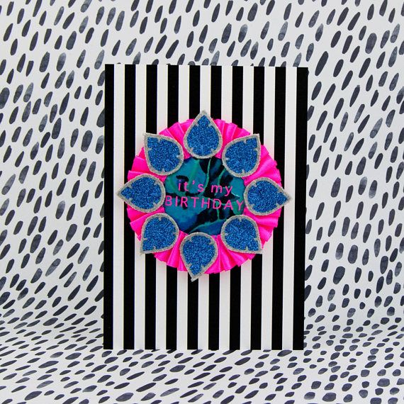 My COLOURFUL CREATIONS look striking on a monochrome pattern. dAKOTA rAE dUST - Neon pink and blue BIRTHDAY BADGE on a stripey A5 card. Handmade rosette printed with 'It's my Birthday'. Birthday card with badge.