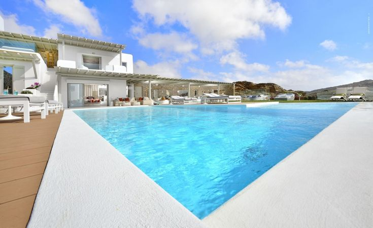 This amazing villa is situated in the island of Mykonos and specifically in the region of Elia beach. You can experience this immense feeling between heaven and earth, once being there and while gazing at the everlasting view extending from Naxos island to the Icarian Sea.