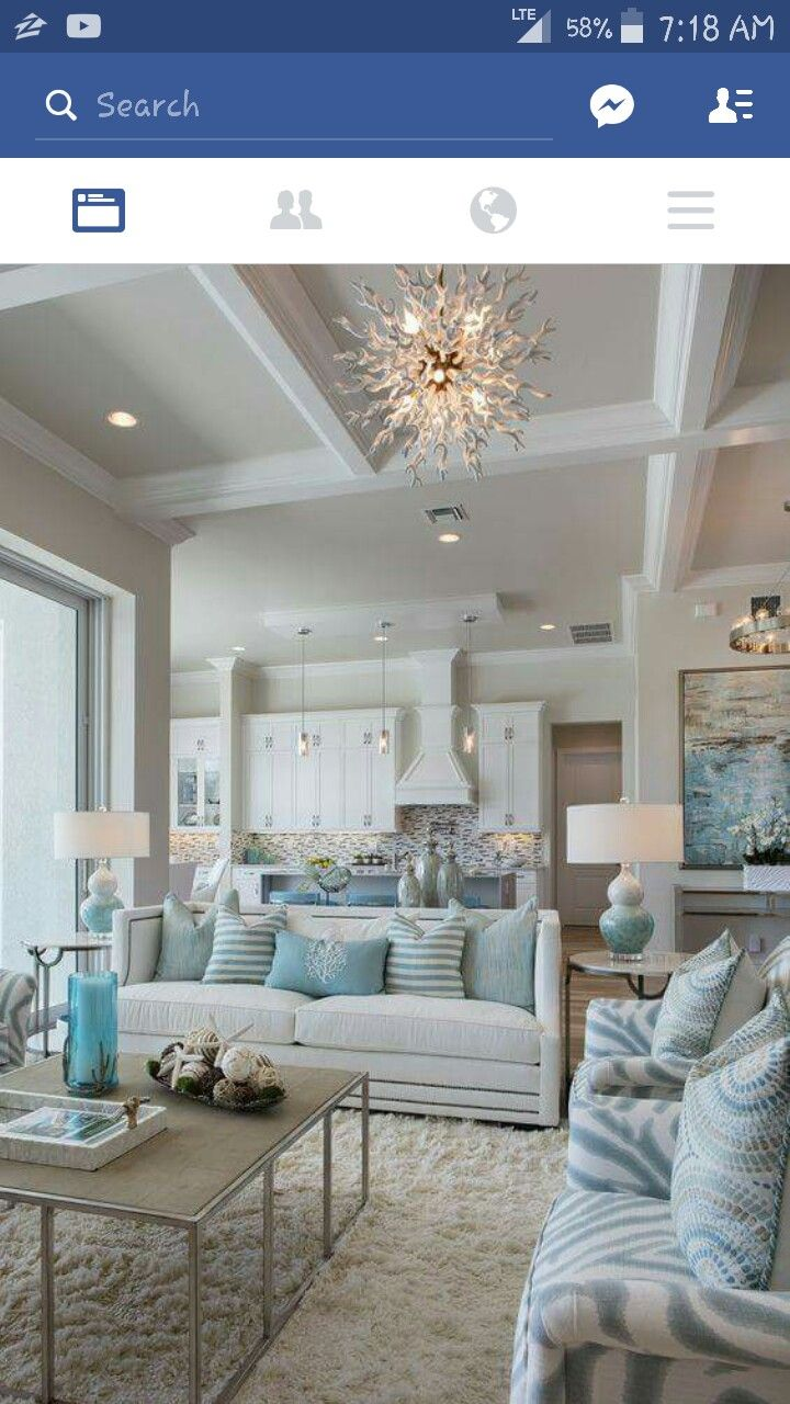 Susan J. Bleda and Amanda Atkins of Robb & Stucky created a coastal style  interior in this Marco Island home by using a color palette of blues, ...