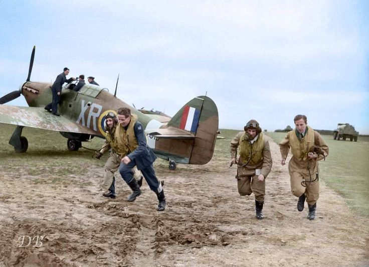 "American pilots of No. 71 ""Eagle"" Squadron scrambling to their Hawker Hurricanes at RAF Kirton in Lindsey, Lincolnshire (March 17, 1941, colorized)."