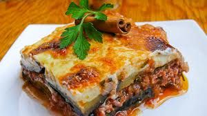 MOUSSAKA is a dish of layered aubergine, ground beef and tomato oven-baked with a thick topping of bechamel sauce