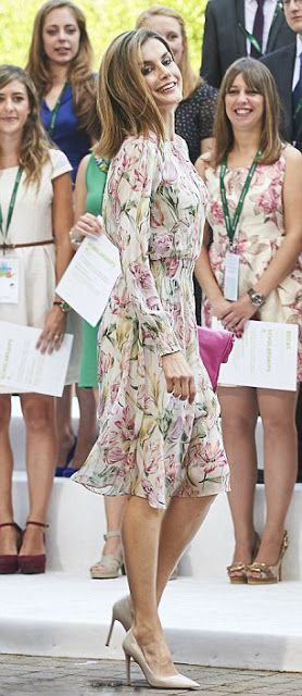 Spanish Queen Letizia wearing a floral midi dress teamed with cream courts for a ceremony held to present Iberdrola 2016 Scholarships