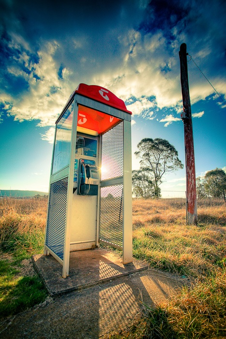 Country Call  Country NSW Australia    A phone booth stands in the middle of nowhere.