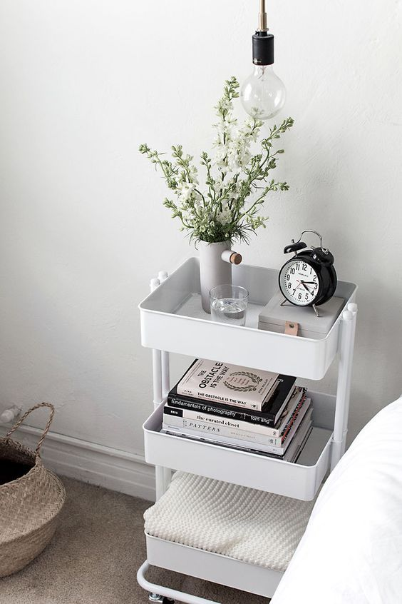 Are you trying to decide whether or not you want to buy a Raskog cart from Ikea? I love this bedside table cart organizing hack! There are so many excellent ways to organize using a Raskog cart & you can see 25 awesome ways to organize kitchen, organize bedroom or any room in your house! My favourite way to use a Raskog cart is to organize art supplies. #organize #organizing #homedecor #homedecorideas #ikea #ikeaideas #hhmuk