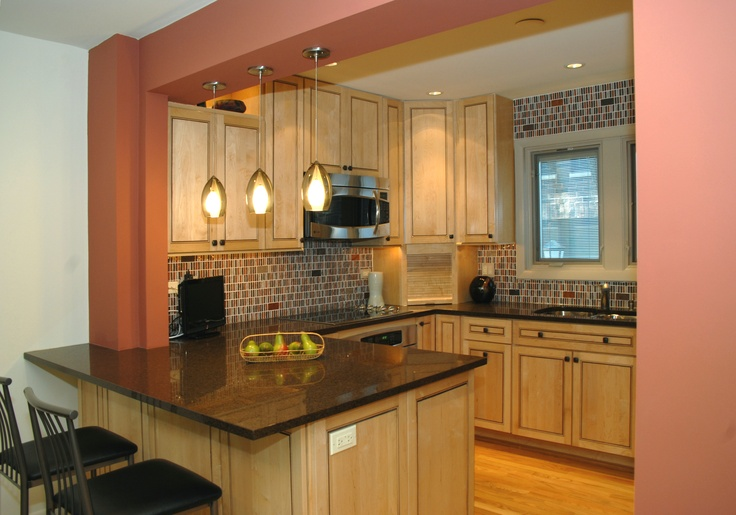 A wall was removed to open this kitchen up to the dining ...