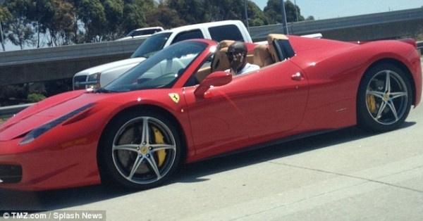 Kobe Bryant in his red Ferrari 458 Italia