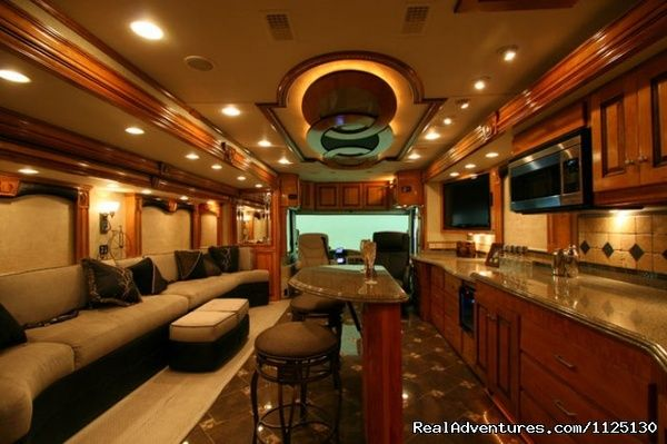 Luxury RV Interior. Modern wood grain and bar.
