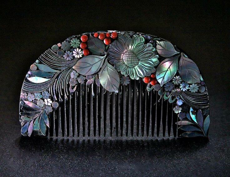 """Ornamental comb from Japan. Taisho era, 1912-26. Made of wood, lacquered black, and decorated with mother of pearl and red glass, presenting a lavish floral arrangement. The finesse with which the shell sections have been tooled is astounding. The decoration would have appealed not only to a Japanese taste during the Taisho period, but also western lovers of Art Nouveau. It still """"sizzles"""" today!! Size: 9.5 x 5.5 cm. Recently acquired from comb collector extraordinaire Kajetan Fiedorowicz."""