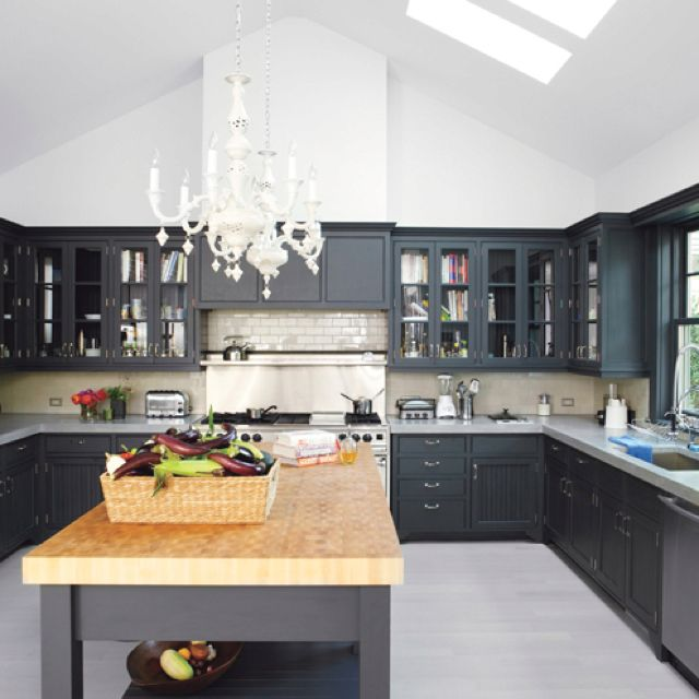 Black cabinets concrete countertops kitchen for Beautiful black kitchens