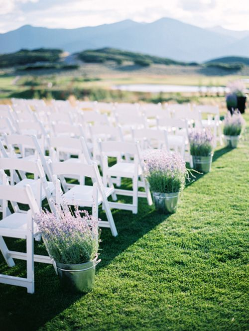 Aluminum pails filled with fresh, fragrant lavender is a simple and chic wedding ceremony idea | Brides.com