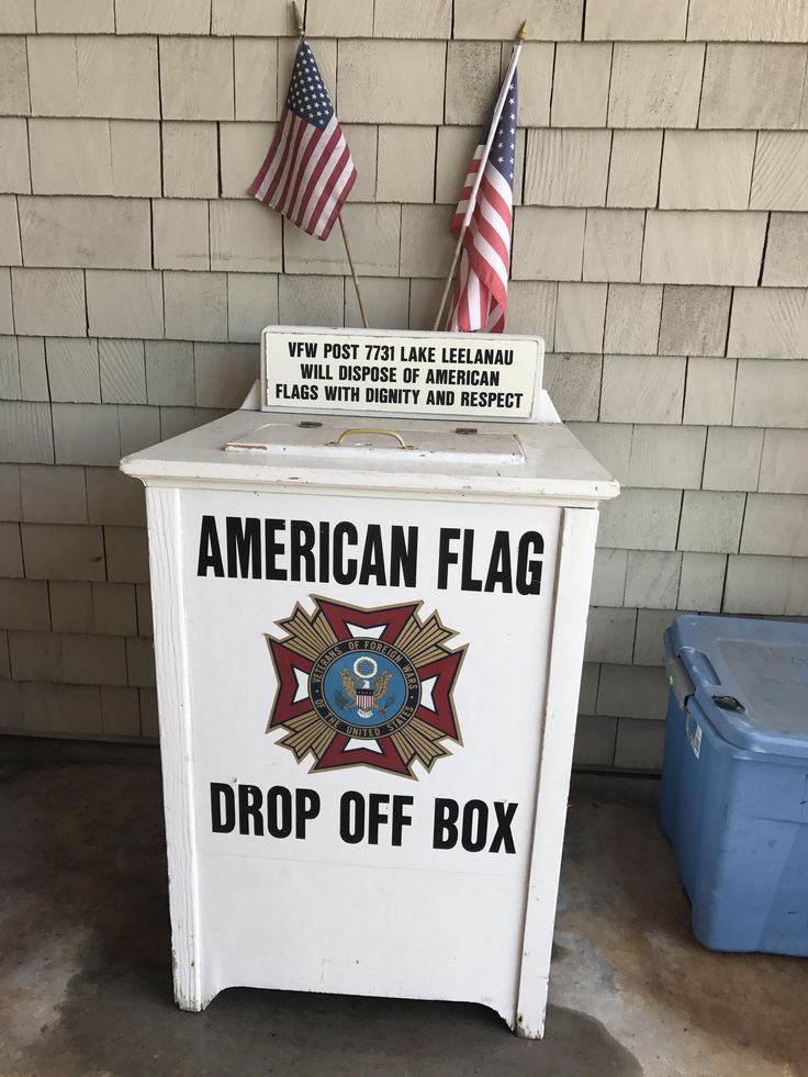 Grocery store has a box where you can dispose of old flags