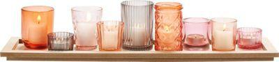 Teelichtschale aus Glas und Holzwerkstoff in der Farbe Rosa/Grau/Braun.
