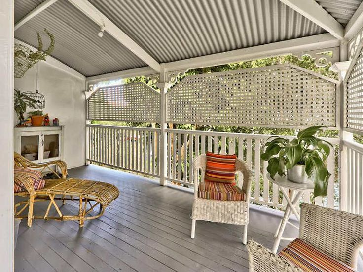 Lattice screens allow breezes but permit privacy on a covered porch