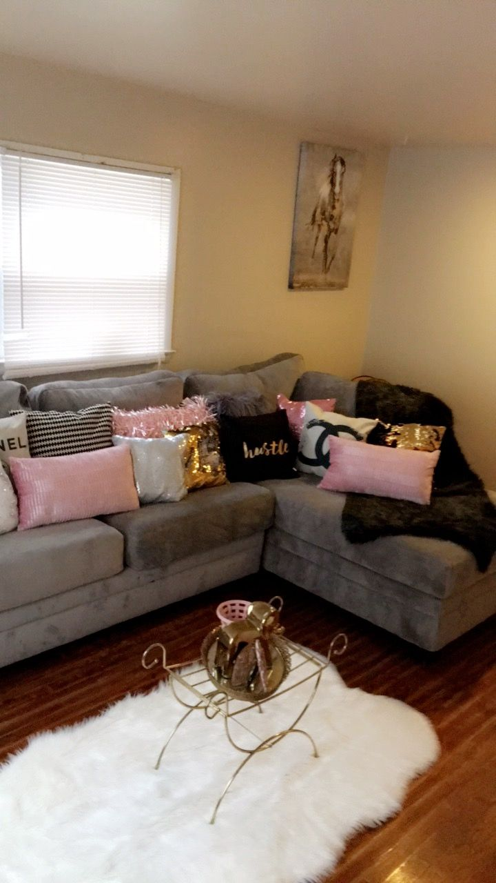 Love the grey couch with the Different styled and textured pink