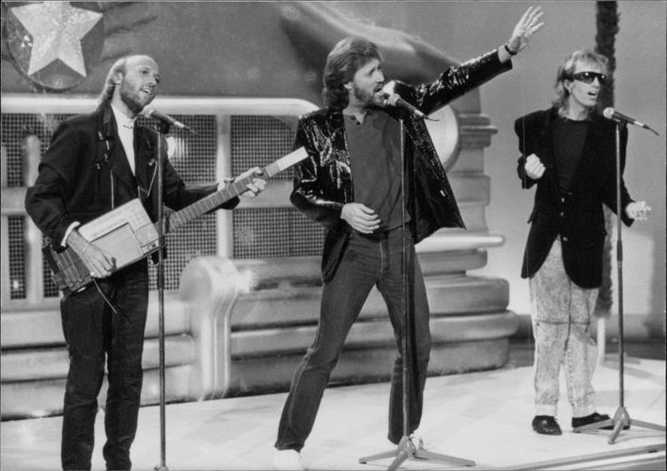 Vintage photo of British rock stars the Bee Gees on stage | eBay