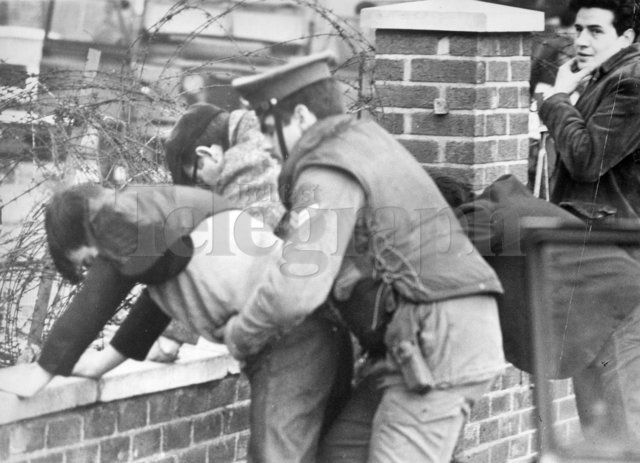 Riots : Belfast. January 1971. Soldiers frisking passengers and driver of a car on the Springfield Road, near Ballymurphy. (14/01/1971) Belfast Telegraph Photosales