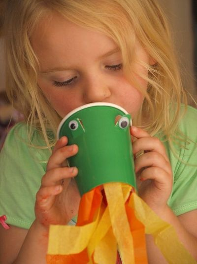 Create your own fire-breathing dragon with a disposable cup, googly eyes, and some fire colored streamers!