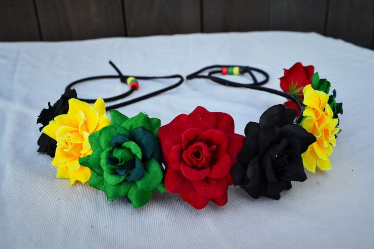 Beautiful Flower Headband With Roses In Rasta Colors Green, Red, Yellow, And Black. Roses Are Attached To Black Suede Leather String That Fastens In The Back. Both Ends Of String Are Decorated With Ma