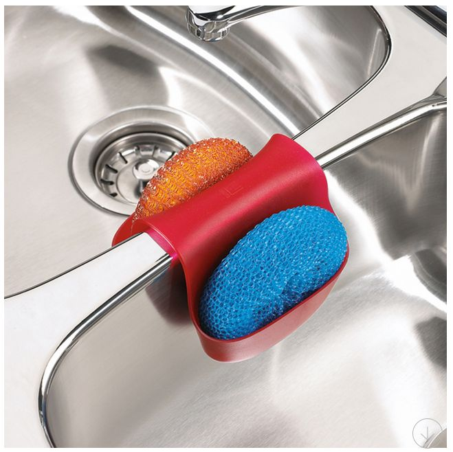 Use the Saddle Sink Caddy by Umbra® over the divider in a double sink to keep sponges and scourers within easy reach. Durable, flexible plastic adapts to a variety of double sinks Drain holes at the bottom allow water to escape Top rack dishwasher-safe