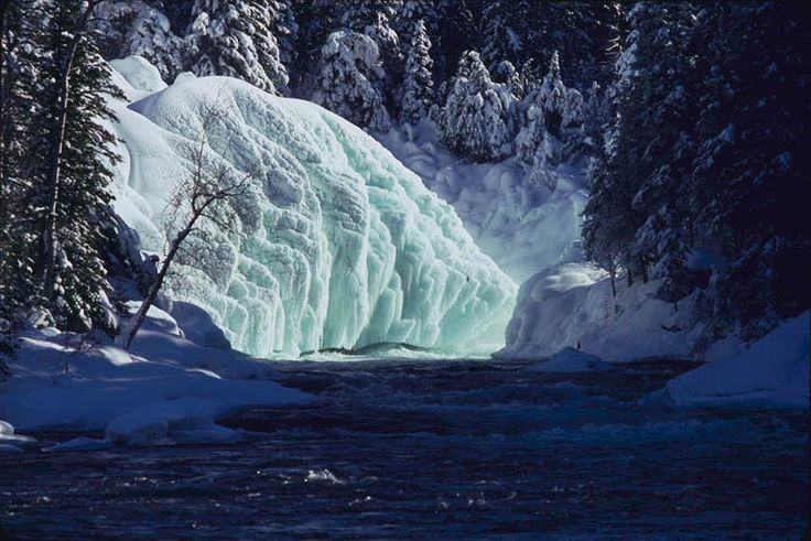 Massive ice sculptures at Nistowiak Fall in Saskatchewan