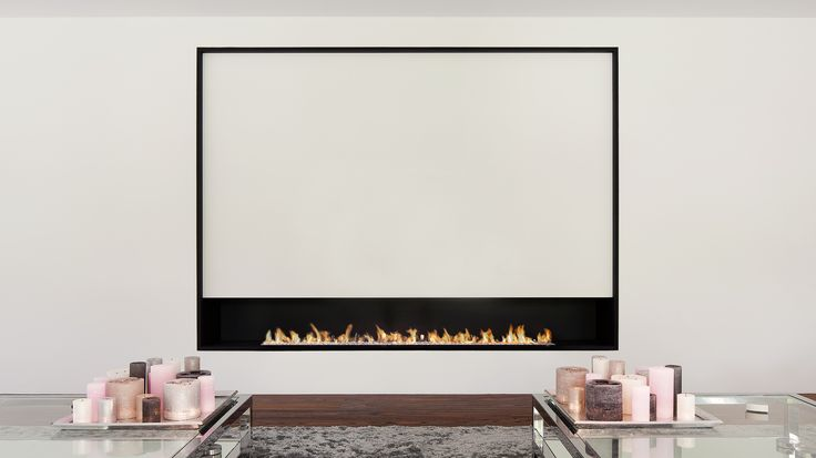 The ultimate contemporary gas hole in the wall fire with a seamlessly integrated 2.4m lineburner . Over this length the dancing flames are truly mesmeric...
