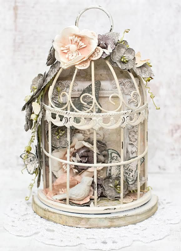 This gorgeous little bird cage is filled with floral beauty and a touch of shabby chic style. Join Tiffany as she alters this beautiful piece with flowers, stamps, papers and more! Watch Tiff teach it on May 26th at 6:30pm PT: http://www.ustream.tv/channel/primaflower #LWP #freeclass #birdcage #homedecor