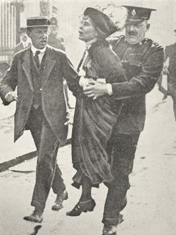 (Just for a day, to have a chance to be as brave as her.) Emmeline Pankhurst, who had founded the Women's Social & Political Union, being arrested as a Suffragette.