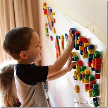 Sensory wall mosaic art - contact paper, pattern blocks, or small foam blocks. A visually stunning sensory experience! From mamasmiles.com