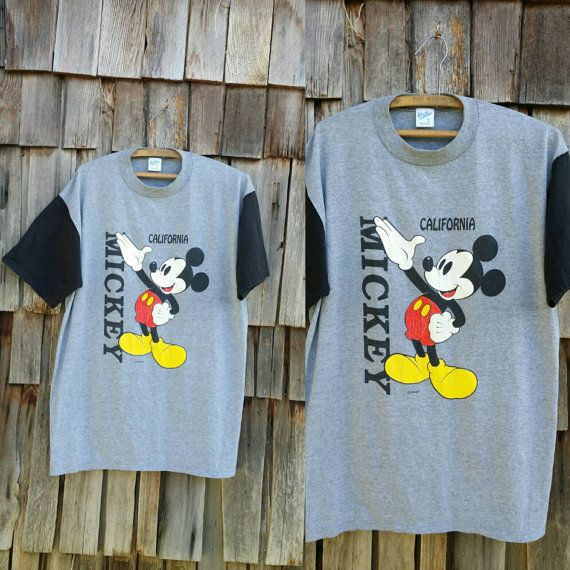 Feel like a child again with all grown up style in this vintage 80s California Mickey Mouse T-shirt. Features the soft vintage you love and Grey/black color combo. *Makes a great baggy tee or true to size *In great vintage condition *Tagged sized:(L) *Measurements: Pit to pit-21