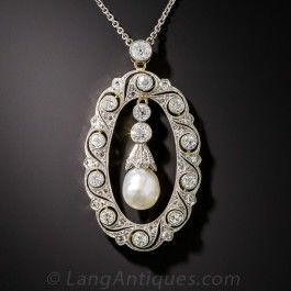 Refined Belle Époque elegance is exemplified in this ravishing pendant necklace. Delicately designed and hand-fabricated in platinum over 18K gold in a striking oval wreath motif, it sparkles all around with bright white, collet-set European-cut diamonds, inside of which a lustrous, natural freshwater pearl drop swings to and fro. Just over 1 1/2 inches by 7/8 inch with 15 inch platinum chain. A rare and radiant Edwardian-era masterpiece.