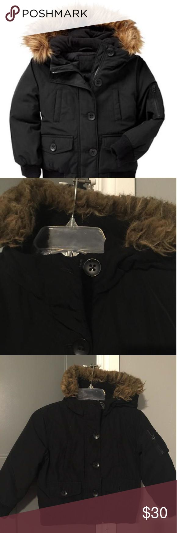 Girls Gap Coat This is a very cute, very warm coat. The faux fur in snaps from the hood so you can wash it. In excellent condition. It zips and buttons. There is a pocket on the sleeve and inside the coat. The size is S(7/8) Gap Kids Dresses