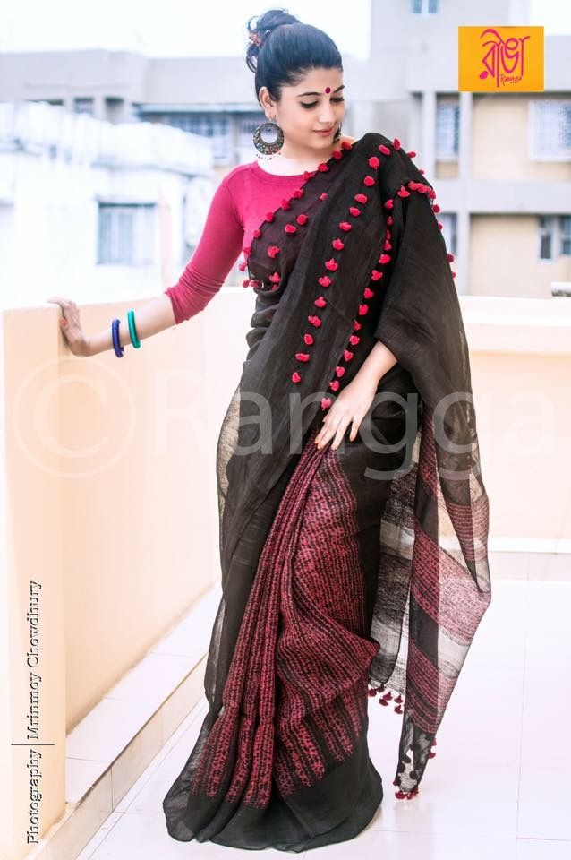 Lovely  black saree with pink tassels