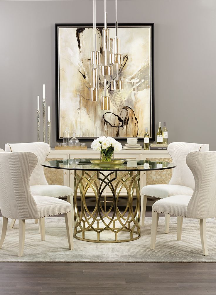 We love the soft colors and all the shimmering, eye-catching elements of this dining room