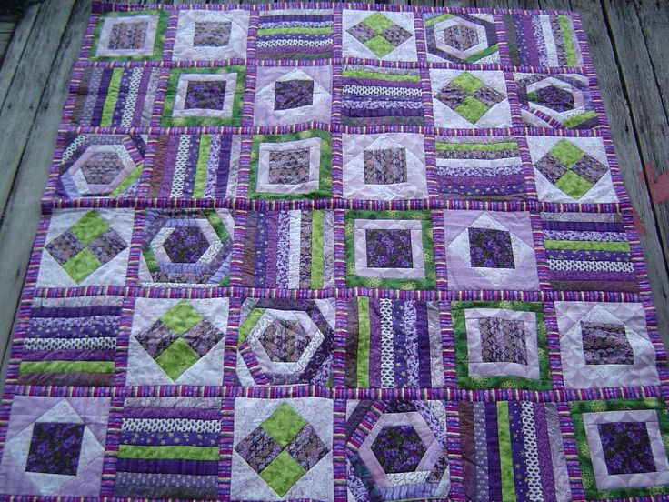 Purple and Green Quilt.  I like the stripes in different order and different directions