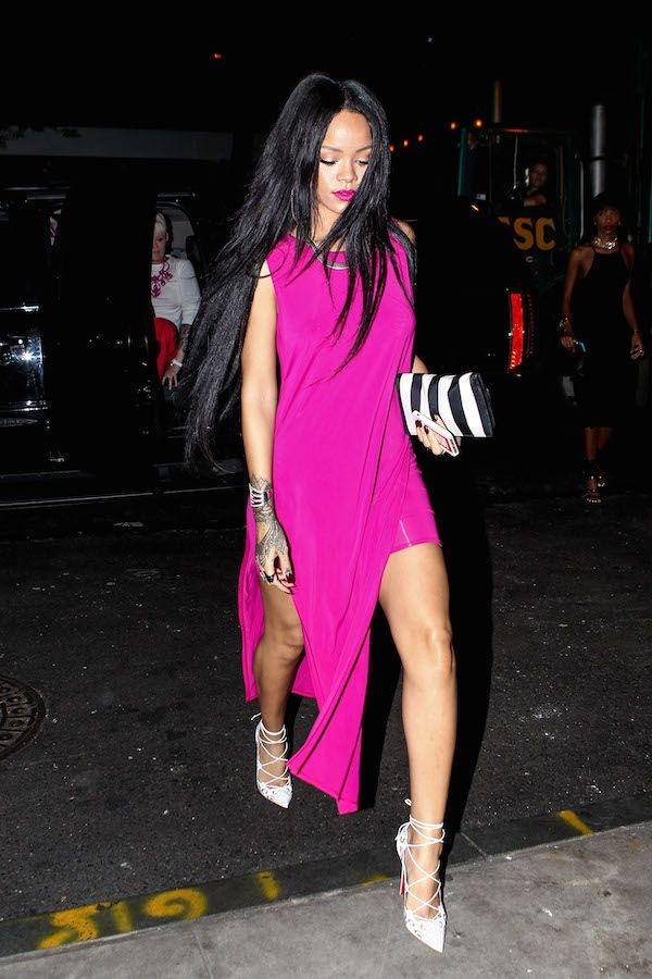 Queen Rih Rih looked resplendent for a night out in NYC in a $425 Helmut Lang Fuchsia High Slit Jersey Dress, $1,295 Christian Louboutin Impera Pumps, and striped clutch from Balmain's Spring 2013 collection.