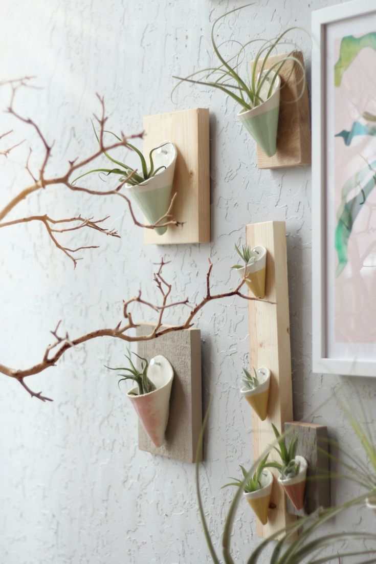 These Ceramic Glazed Wall Planters Are Mounted To Various