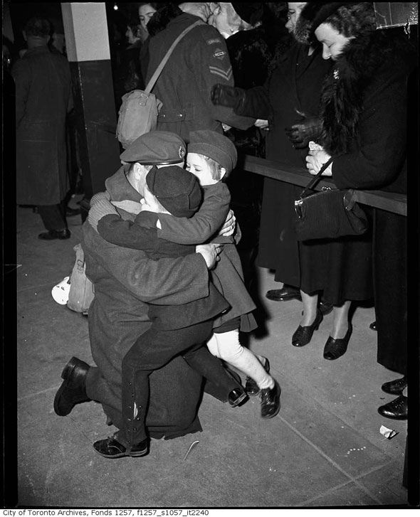 Toronto 1940s Returning soldier embraces children at Union Station http://www.blogto.com/city/2015/01/a_1940s_toronto_photo_extravaganza/