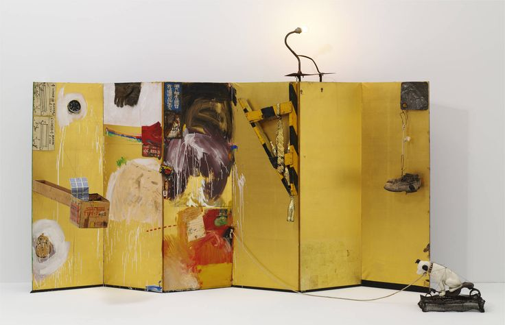 Gold Standard by Robert Rauschenberg (American, 1925-2008).  1964. 85 x 142 x 51 1/4 in Oil, paper, printed reproductions, clock, cardboard box, metal, fabric, wood, string, shoe, and Coca-Cola bottles on folding Japanese screen, with electric light, rope, and ceramic dog on bicycle seat and wire-mesh base. #installation