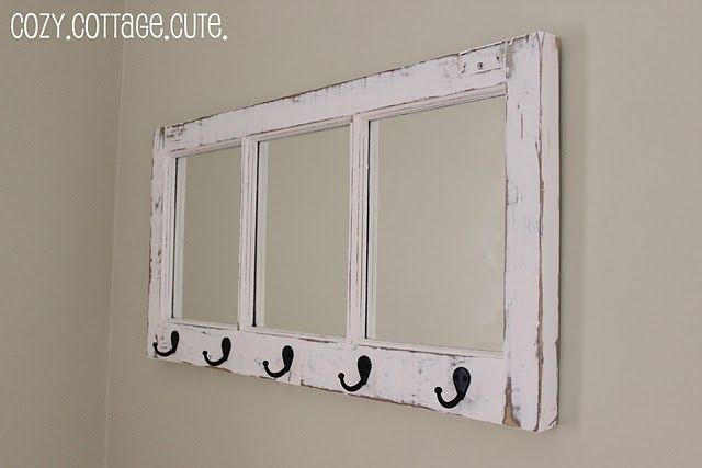 They put mirrors inside of the windows and added hooks! This is darling!!  Love it!