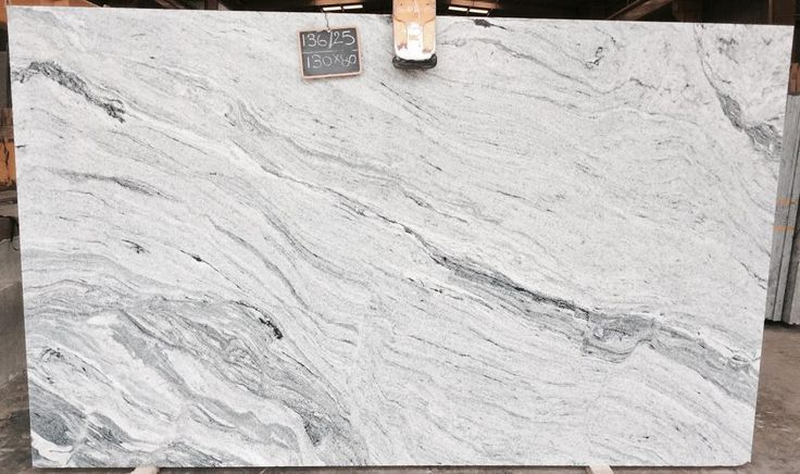 Viscon White Granite Countertops at Ecstatic Stone in Columbia, South Carolina. Premium quality granite slabs with a white to grey canvas and gentle movement. We have a 25,000 square foot warehouse stocked with granite, marble, and quartzite slabs, so even when we're low on inventory, we still have tons (literally) of beautiful, natural stones to choose from! #granite #kitchen #countertops #columbia #southcarolina #distributor