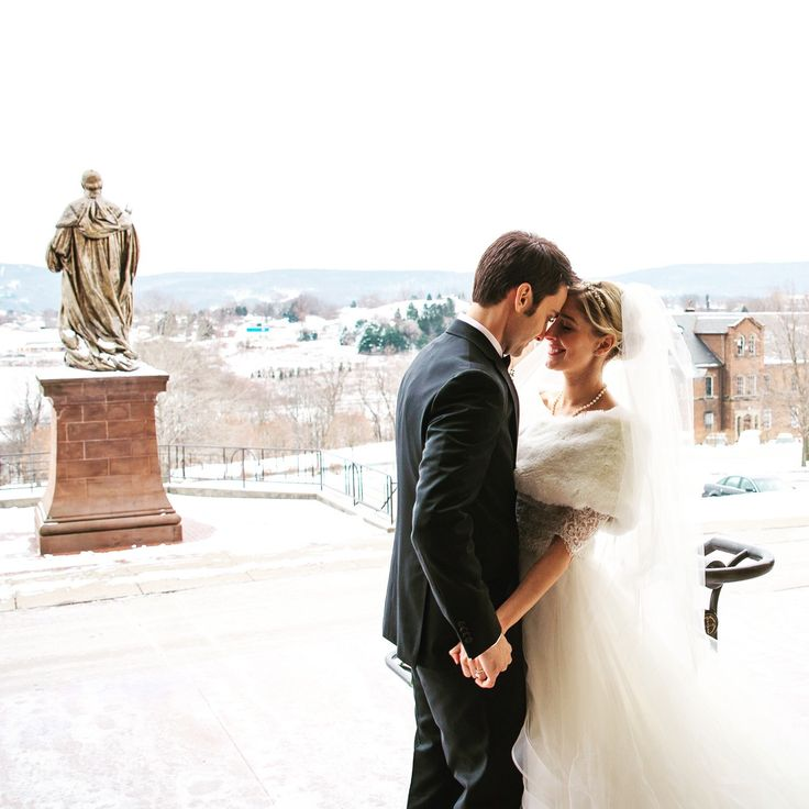 A gorgeous #winterwedding #truelove #happiness Elizabeth is wearing our Marcie faux fur wrap in Ivory #americanwedding #pittsburgh