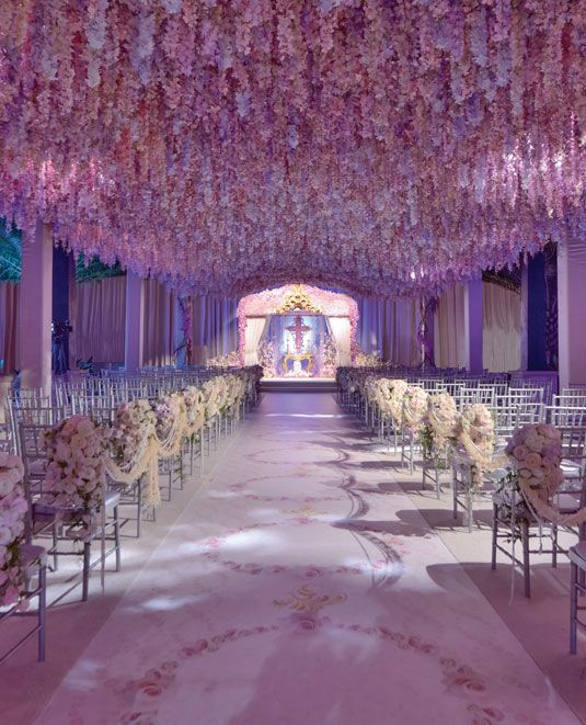 Wedding flower idea: a ceiling of pink flowers.